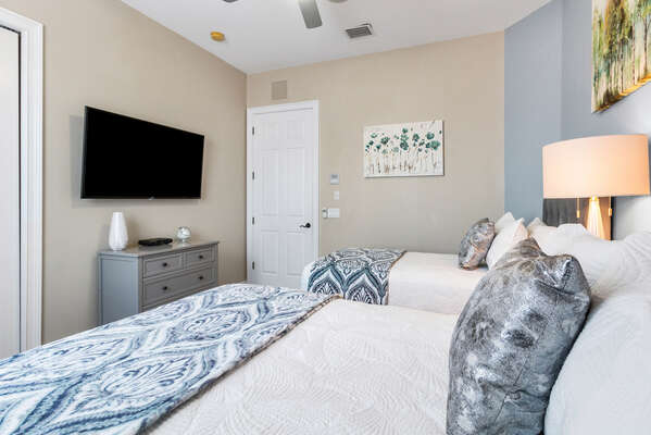 Watch your favorite show before bed in this comfortable bedroom