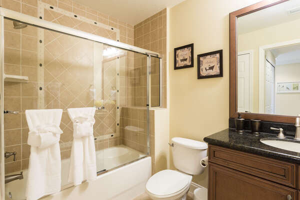 A full bathroom with shower and tub combo