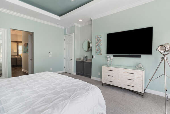 The bedroom features a comfortable King bed, 70-inch SMART TV and Keurig coffee maker in-room