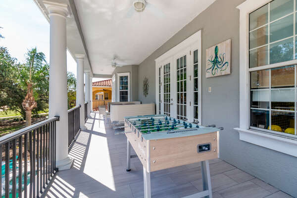 Enjoy spending time relaxing on the large balcony overlooking the Watson golf course with outdoor foosball
