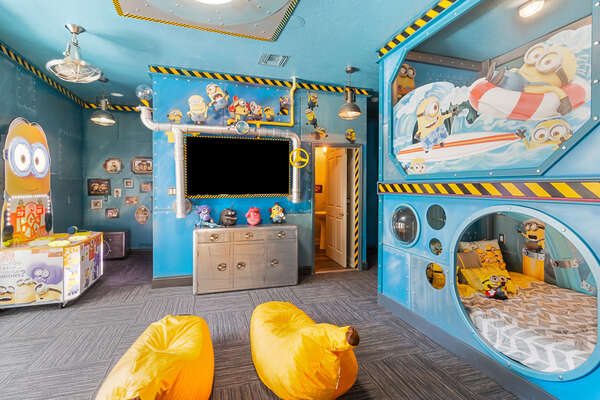 So many fun surprises for everyone in this bedroom, including a 70-inch SMART TV and Minion-favorite banana bean bags