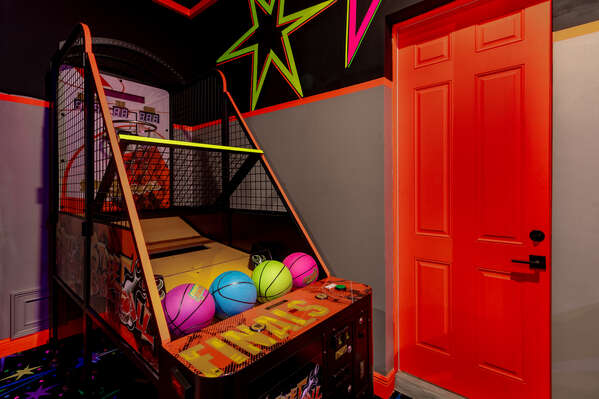 Challenge your family members to shoot hoops at the neon basketball arcade game