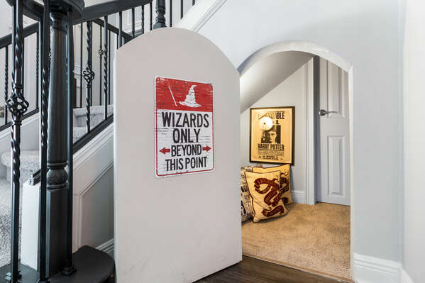 Fun details are found throughout the home, like this secret playroom underneath the stairs