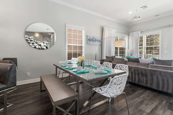The formal dining table seats 8, located next to the breakfast bar with seating for 4