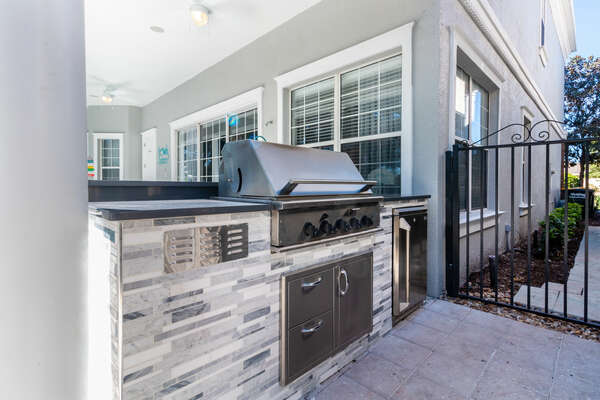 Summer kitchen is perfect for a BBQ by the pool