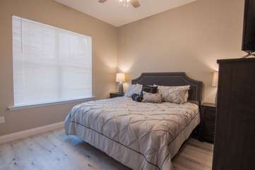 This contemporary guest bedroom is located on the 1st floor with a serene king size bed