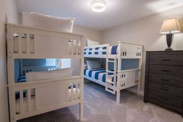 Stylish upstairs guest room with two sets of bunk beds to sleep 4 comfortably