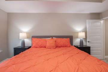 Vivid, comfortable king bed located in upstairs master bedroom
