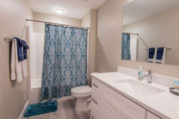 Basically feel the ocean as soon as you walk into this blue and bright guest bathroom