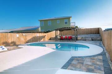 Back yard pool view with private fence