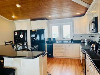 Kitchen with side by side refrigerators and ice machine