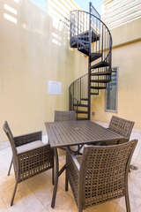 private outdoor patio space with access to rooftop deck