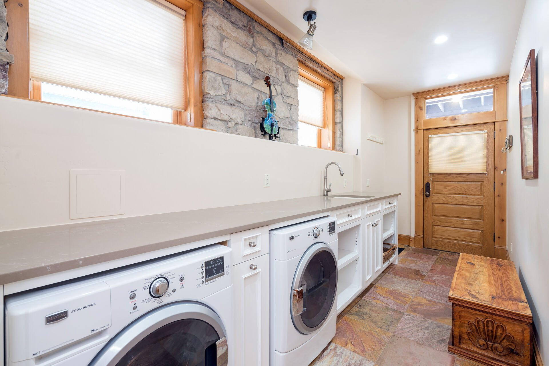 Hallway with washer and dryer