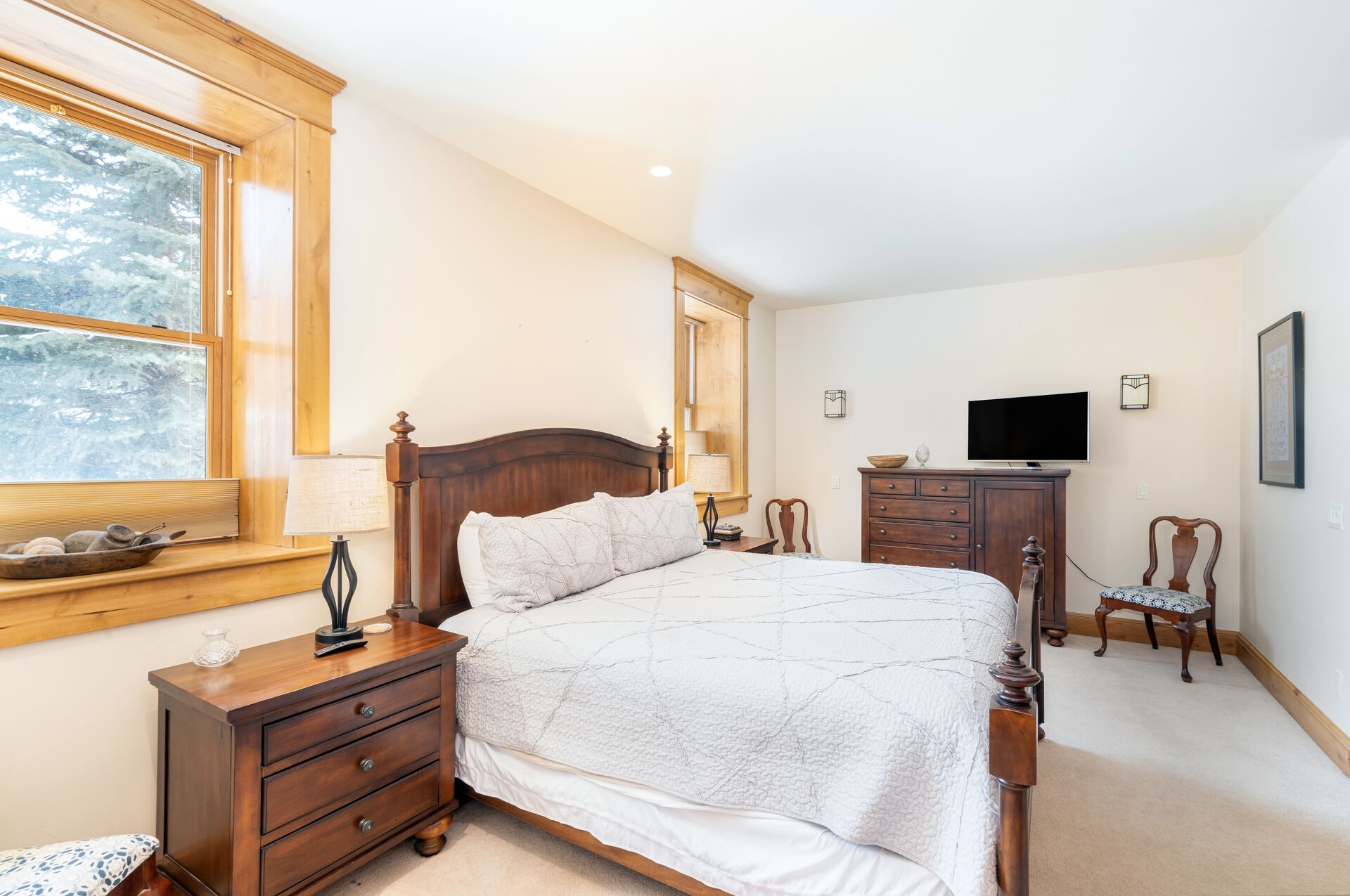 Master bedroom with dresser and HD TV