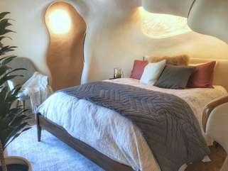 The Bloomhouse | BedroomQueen bed, deck view