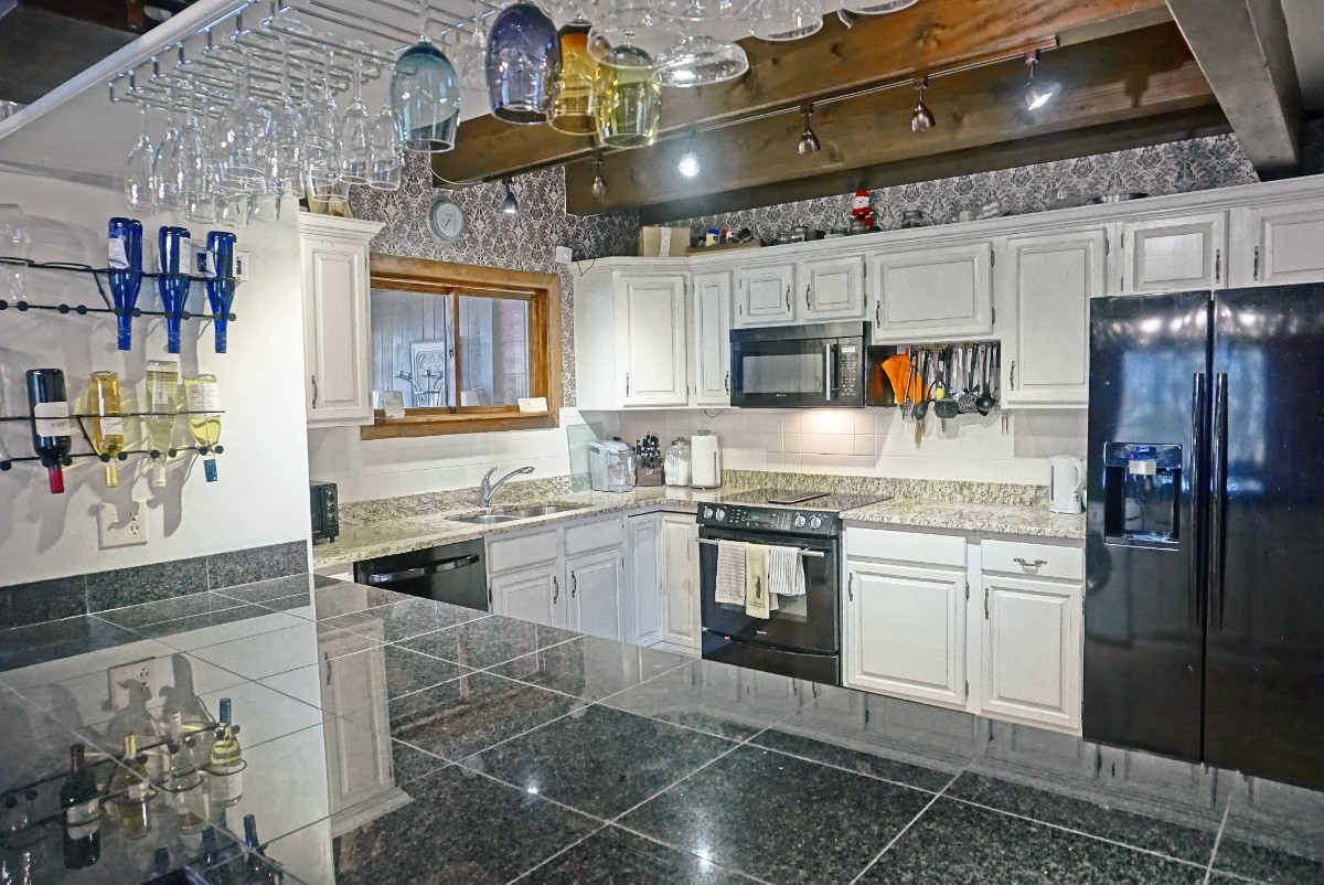 This Waterford townhome has a large kitchen and bar