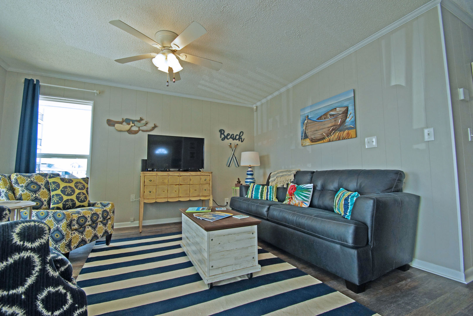 Sofa, Arm Chair, Tables, Window, TV, and Ceiling Fan.
