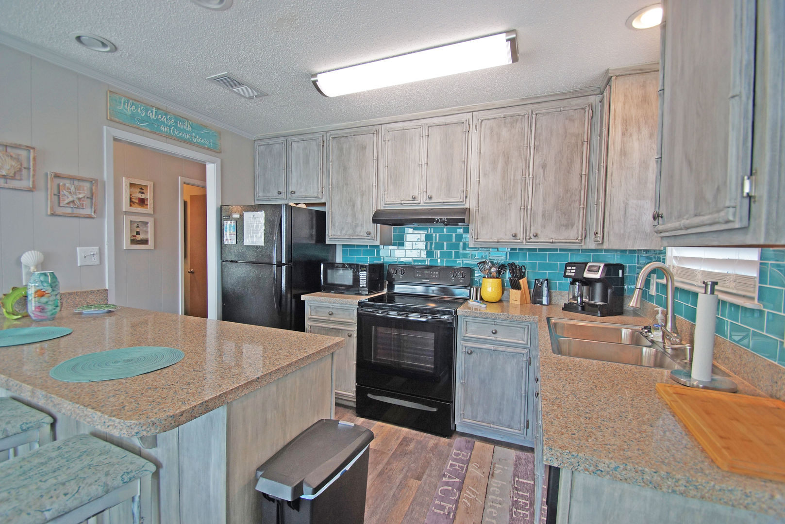 Kitchen with Counter, Refrigerator, Microwave, and Coffee Maker.