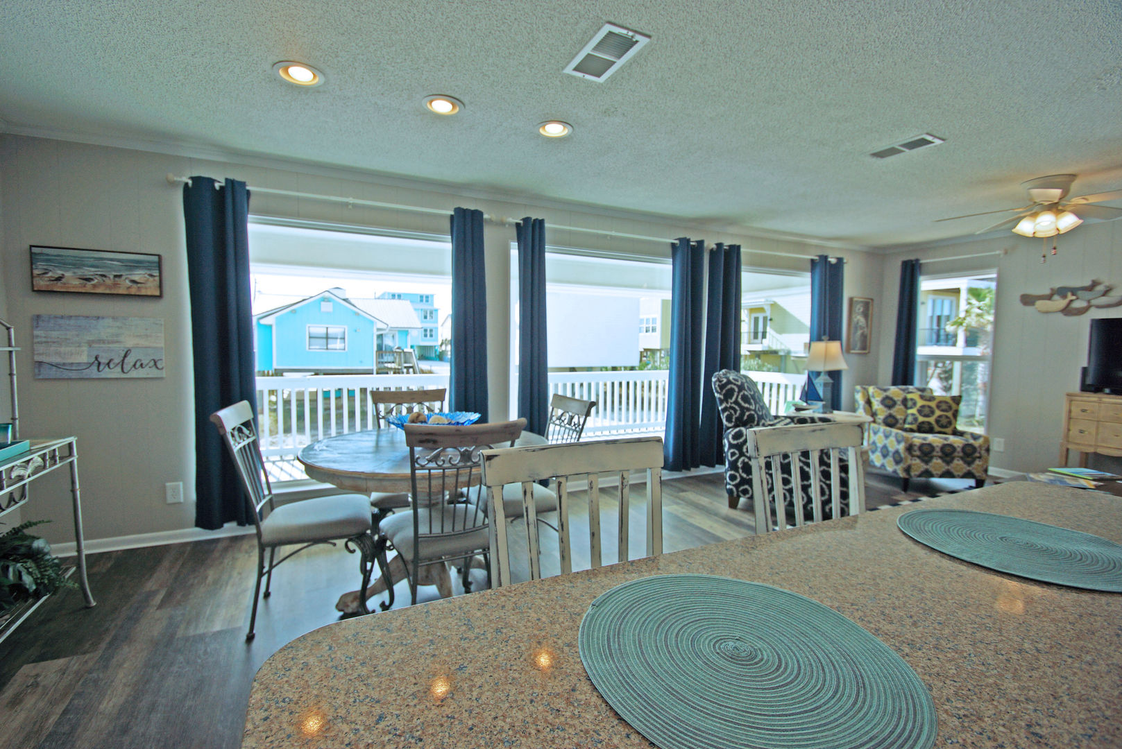 Kitchen Counter, Stools, Dining Table, Chairs, Arm Chairs, and Windows.