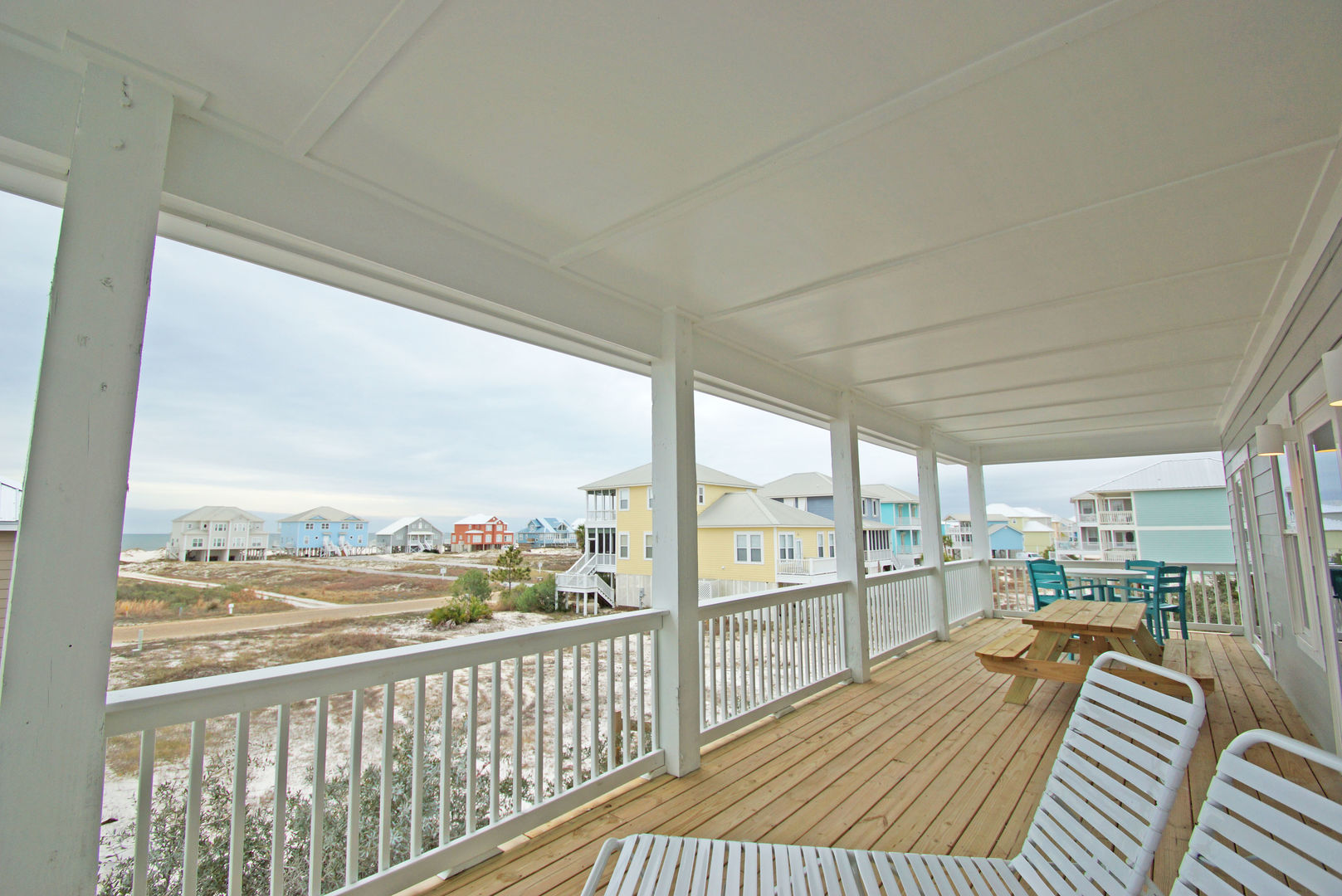 Covered balcony of this Vacation Home For Rent In Gulf Shores, Alabama.