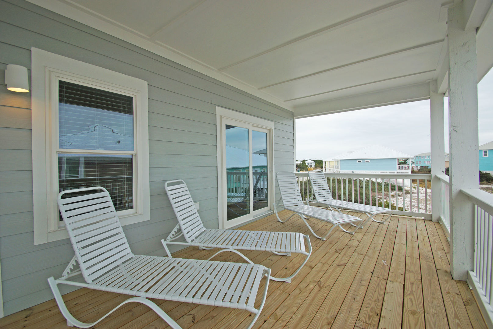 Plenty of area to lounge on the covered balcony with these lounge chairs.