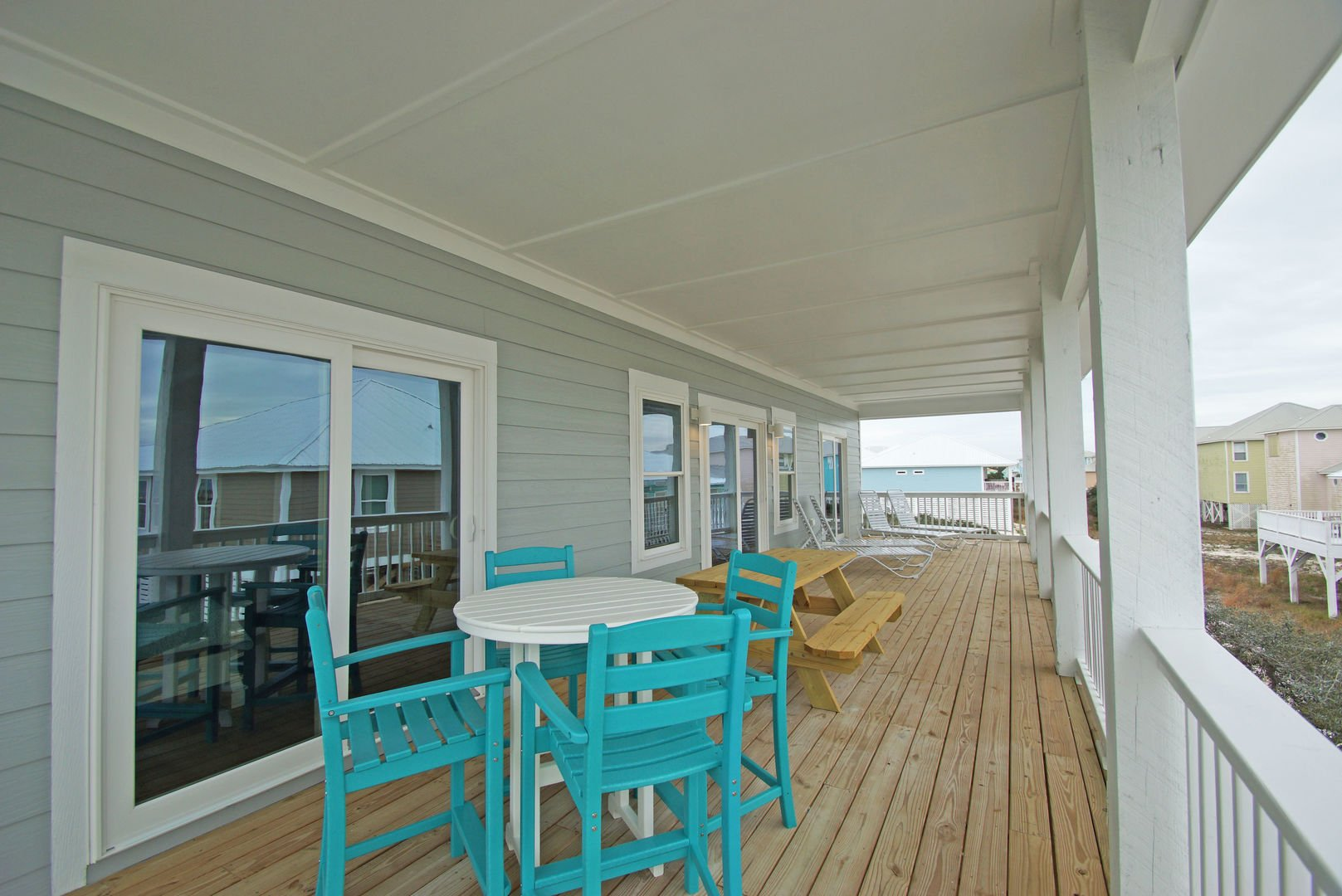 Additional balcony area to catch the sunrise with seating and tables.