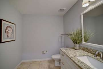 Guest half bath with granite counter tops