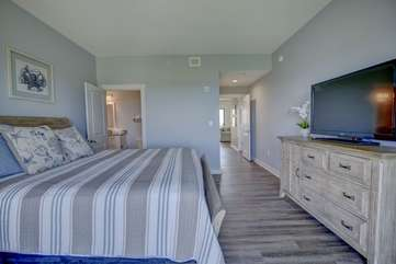 Guest bedroom with queen size bed and large flat screen TV