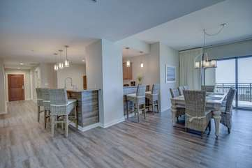 This open set up of the kitchen and dining area along with the coastal feels of this space provide for a relaxing environment while on vacation