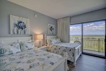 Beach themed guest bedroom with two full beds