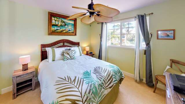 Queen Bedroom with ceiling fan and two nightstands
