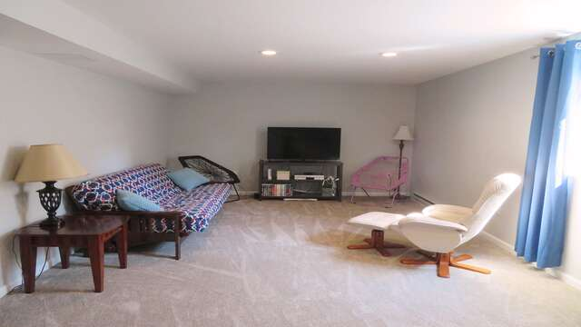 Enjoy watching your favorite DVD or playing with the Wii game console in the lower level game room-10 Melva Street South Yarmouth Cape Cod New England Vacation Rentals