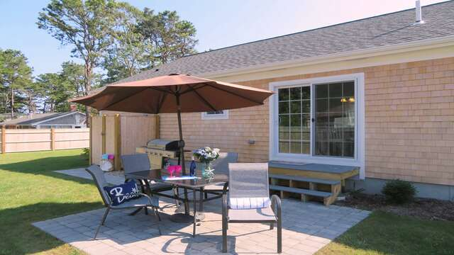 Easy access for the kitchen and dining area out to the patio and backyard-10 Melva Street South Yarmouth Cape Cod New England Vacation Rentals
