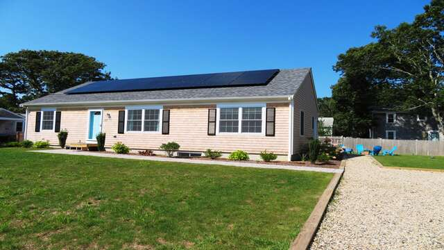 Large front yard with long driveway leading to side entrance, driveway fits 4 cars easily-10 Melva Street South Yarmouth Cape Cod New England Vacation Rentals