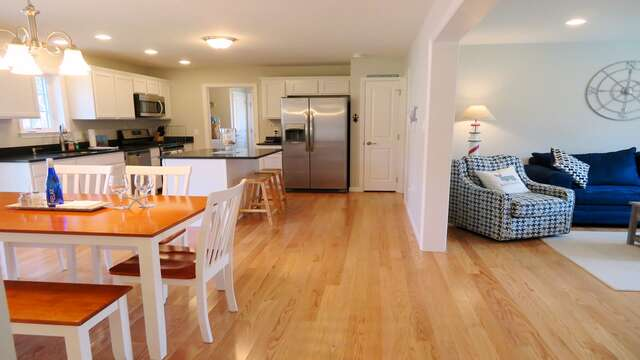 View of open kitchen, dining and living areas-10 Melva Street South Yarmouth Cape Cod New England Vacation Rentals