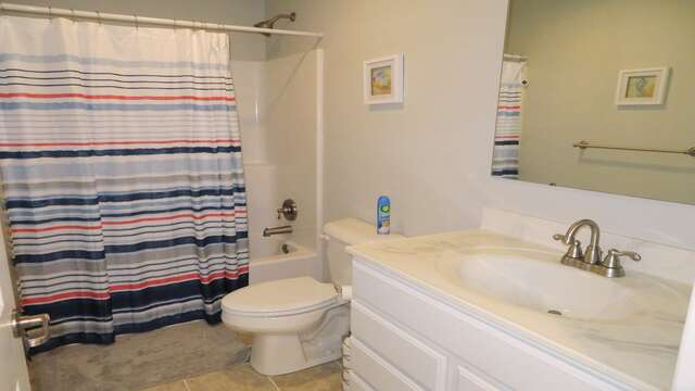 Full bath off of hallway with tub and shower-10 Melva Street South Yarmouth Cape Cod New England Vacation Rentals