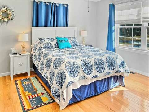 Master bedroom is off the kitchen on main living level-10 Melva Street South Yarmouth Cape Cod New England Vacation Rentals