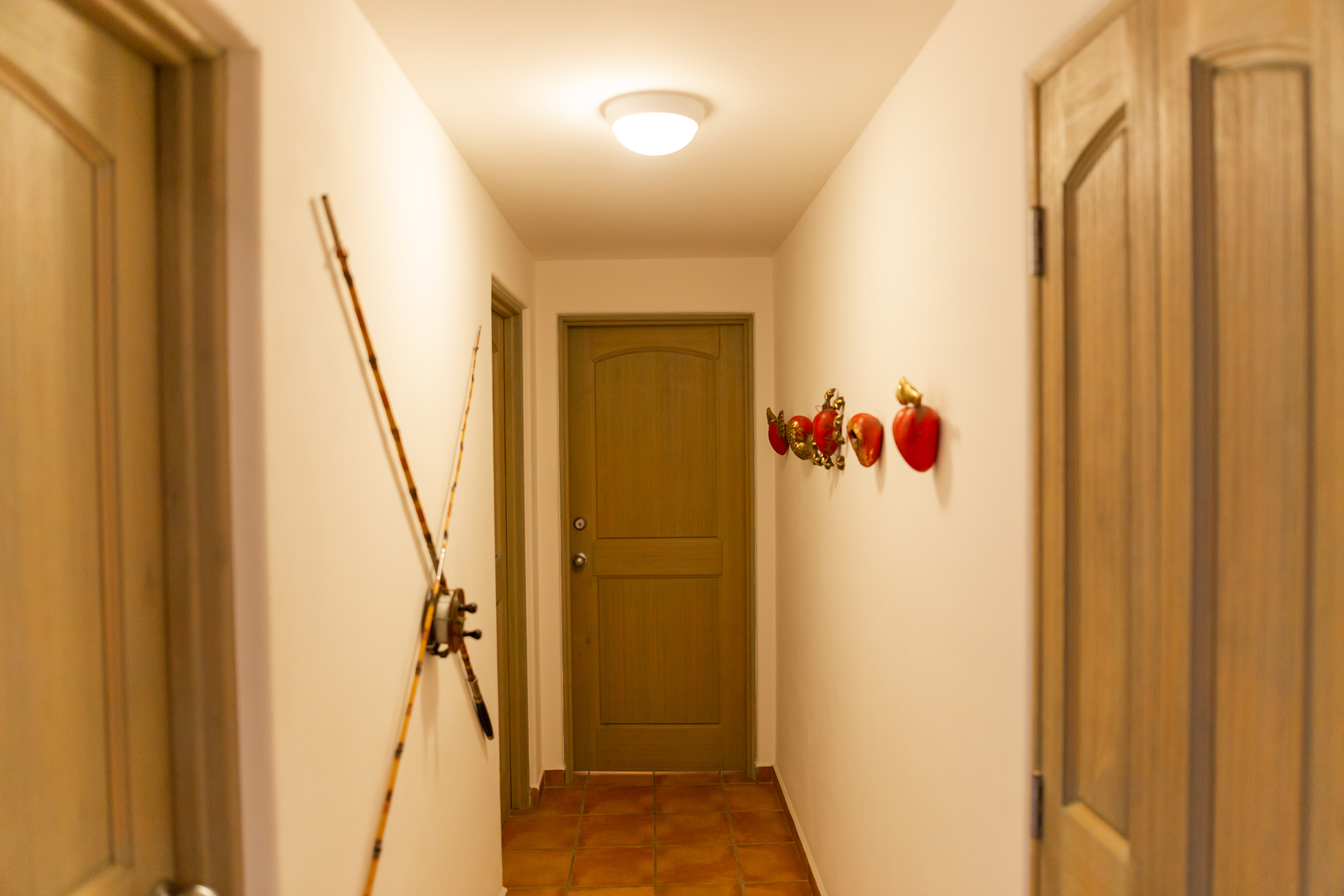 HALLWAY TO LAUNDRY AND GUEST BEDROOM