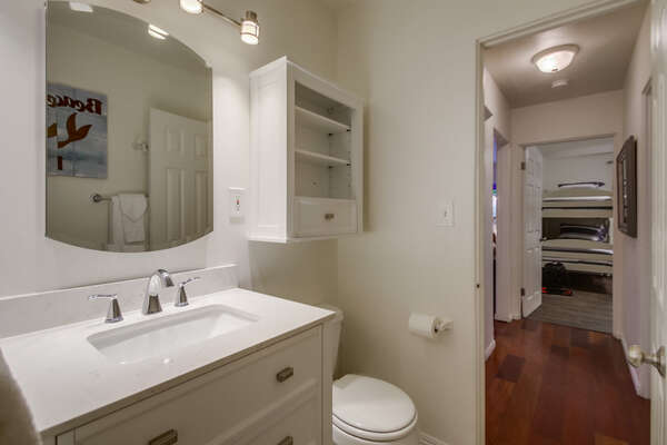 Single Sink Vanity, Mirror, Wall Cabinet, and Toilet