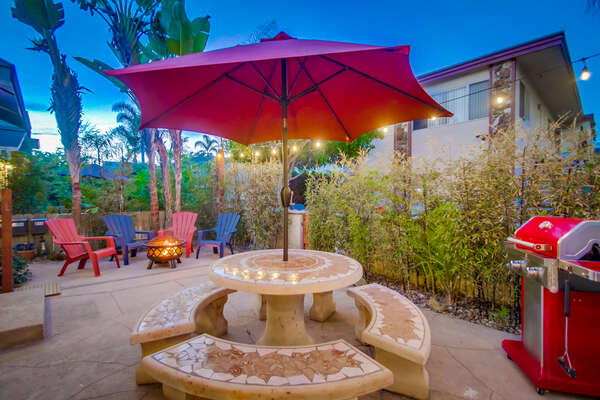 Picnic Table, Patio Umbrella, Chairs, Fire Pit, and Grill in the Front Patio.