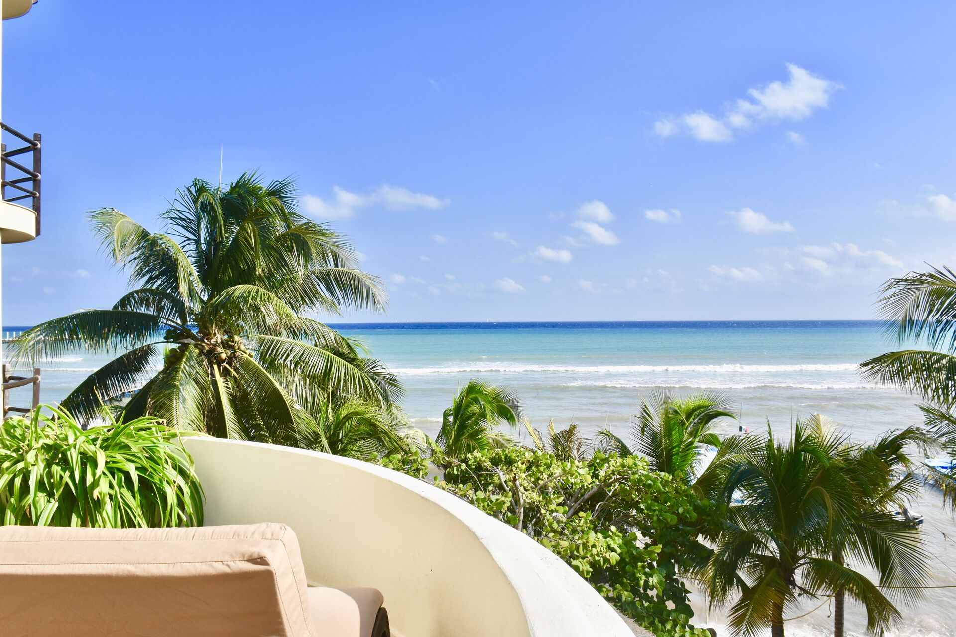 Ocean front suite, incredible ocean view balcony with chairs and hammock.