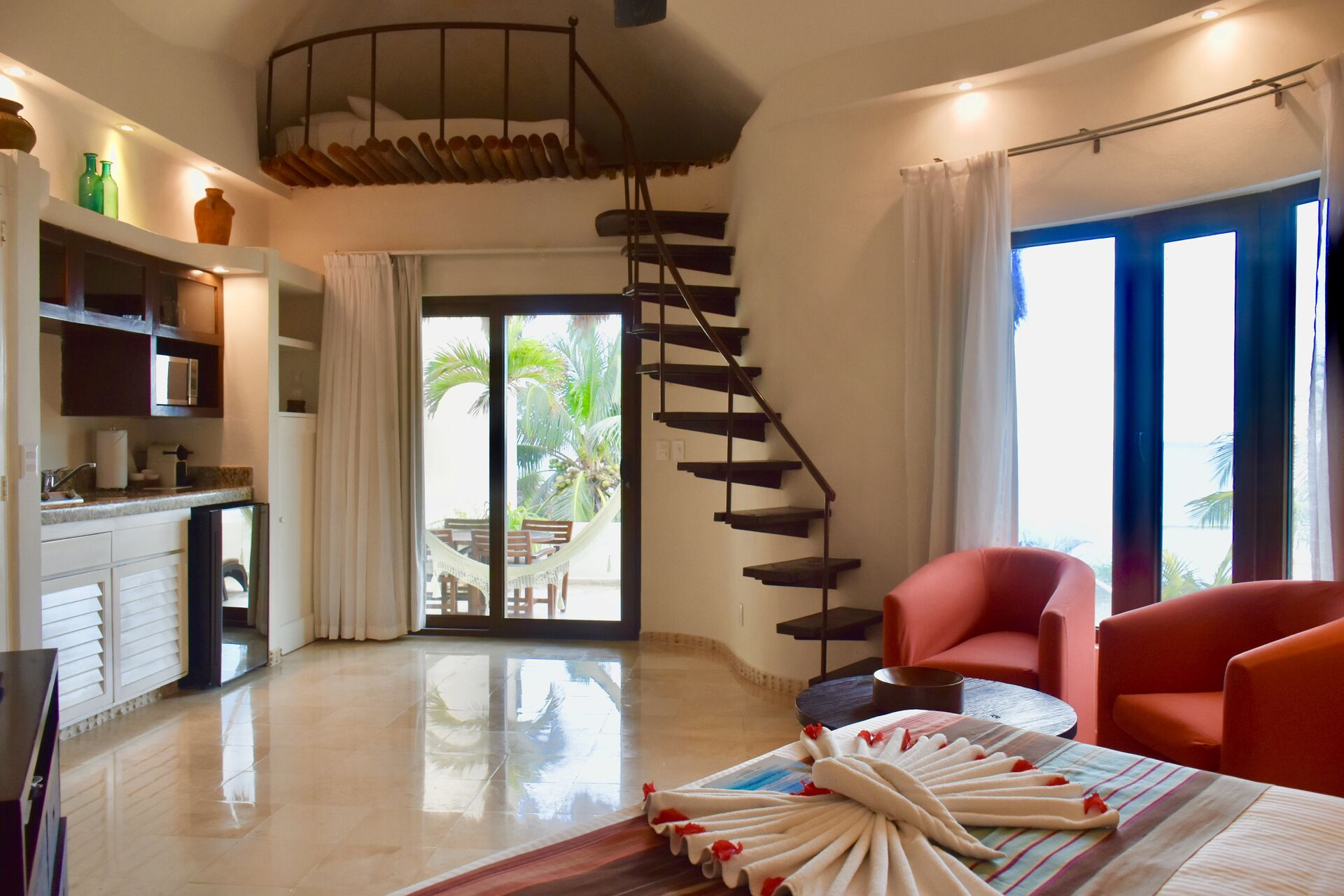 Fully furnished ocean front suite with queen size bed and kitchenette.