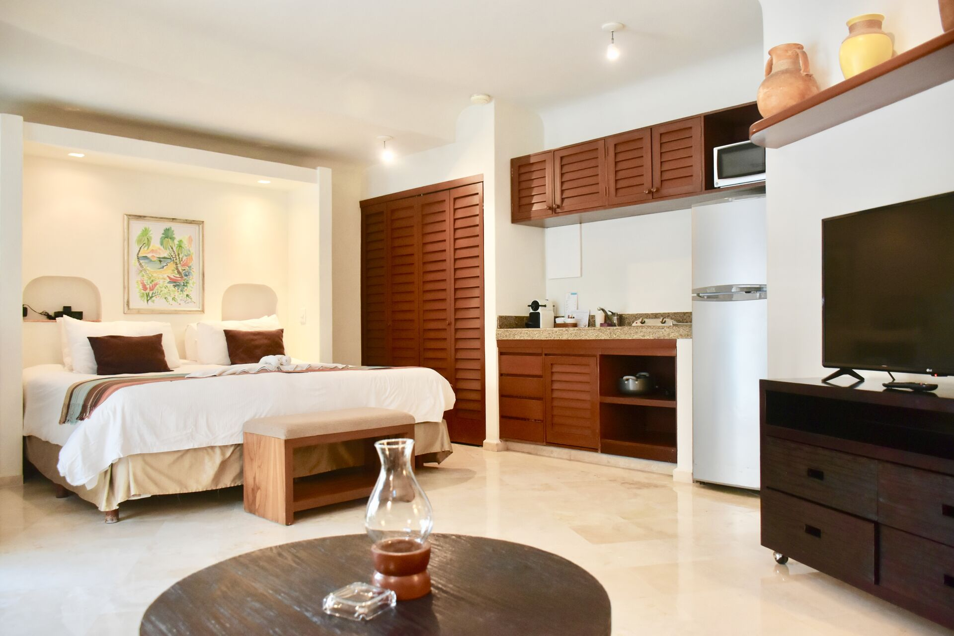 Ocean view room with king size bed and kitchenette.