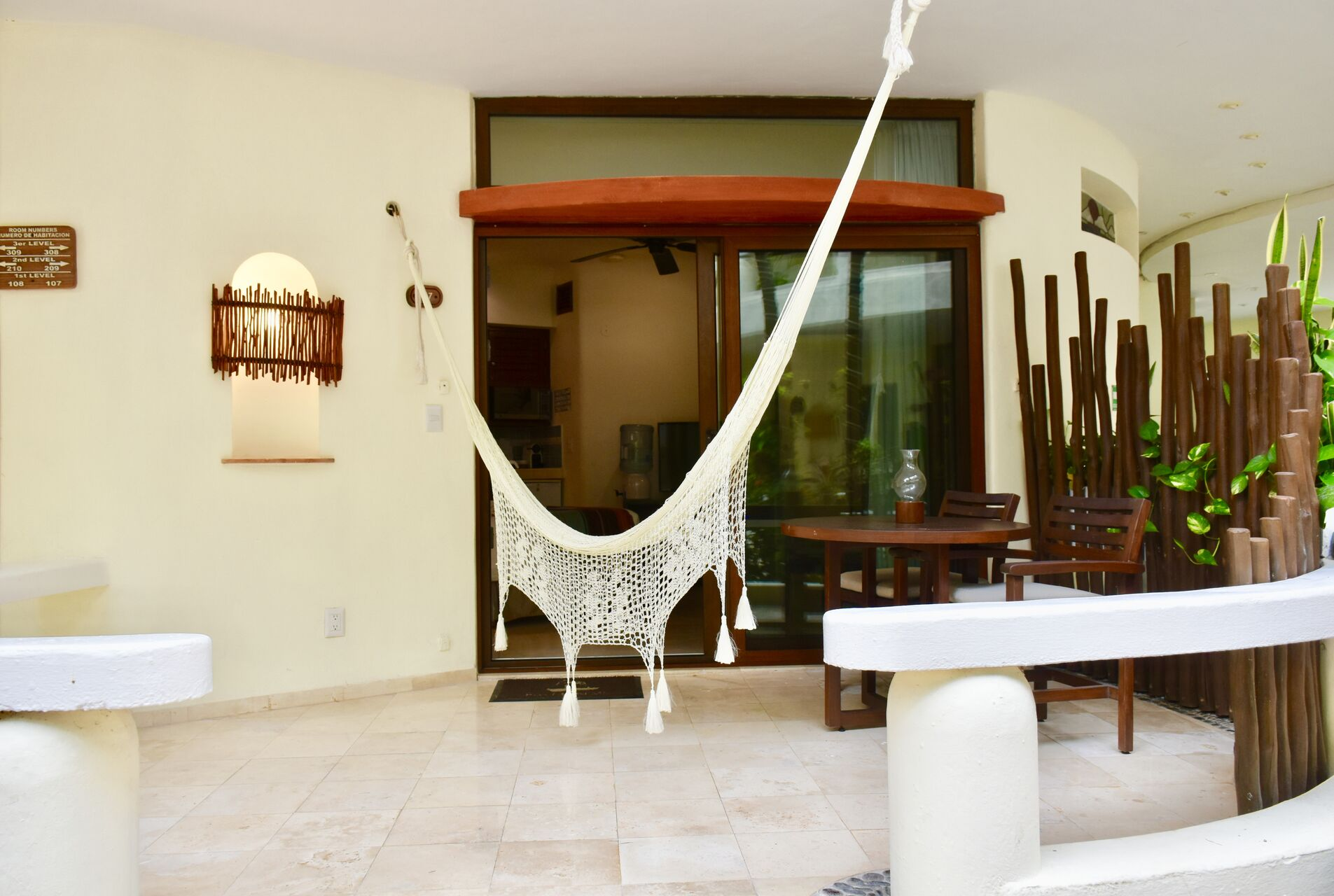Large balcony with chairs and hammock.