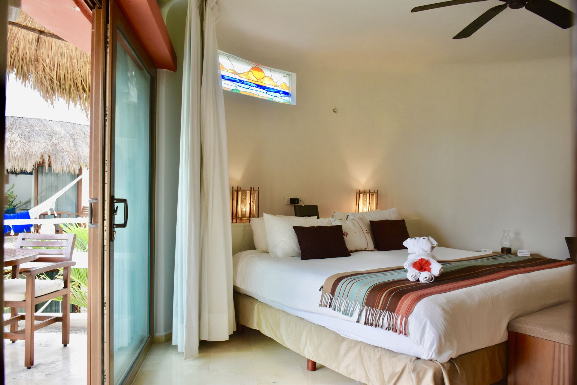 Fully furnished ocean view suite with king size bed and kitchenette.
