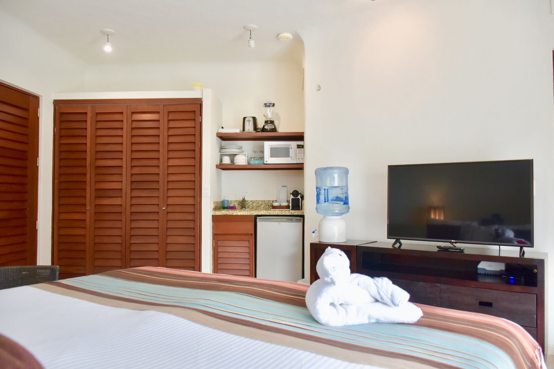 Amazing ocean view suite with king size bed and kitchenette.