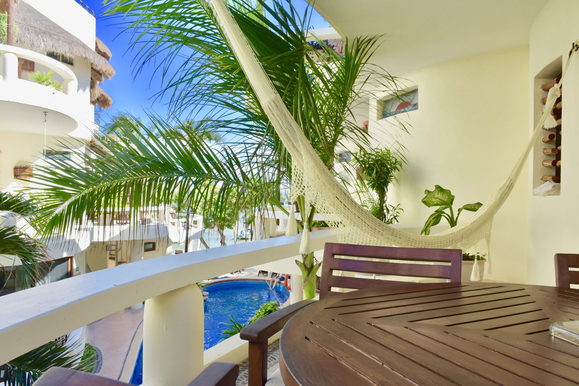 Ocean view balcony with chairs and hammock.Ocean view balcony with chairs and hammock.