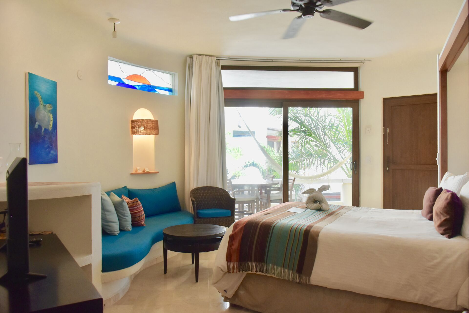 Fully furnished ocean view suite with queen size bed and kitchenette.