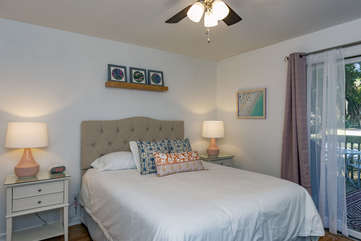 Second bedroom has a queen bed and sliding doors that lead to the deck.