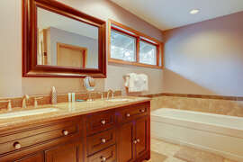 Master bath has twin sinks, extra long bathtub, separate shower and private toilet room.